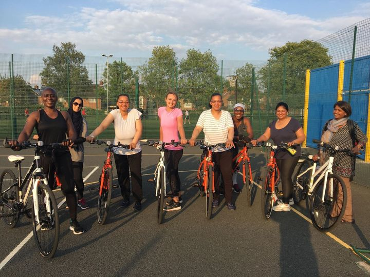 Me (centre, pink top) and the other women in my cycling group.