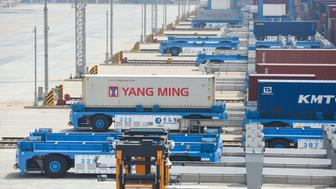 Automated guided vehicles (AGV) are seen at an automated container terminal in Qingdao port, Shandong province, China June 8, 2018. Picture taken June 8, 2018.   REUTERS/Stringer ATTENTION EDITORS - THIS IMAGE WAS PROVIDED BY A THIRD PARTY. CHINA OUT.