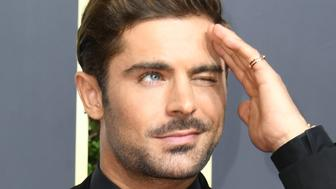 Zac Efron arrives for the 75th Golden Globe Awards on January 7, 2018, in Beverly Hills, California. / AFP PHOTO / VALERIE MACON        (Photo credit should read VALERIE MACON/AFP/Getty Images)