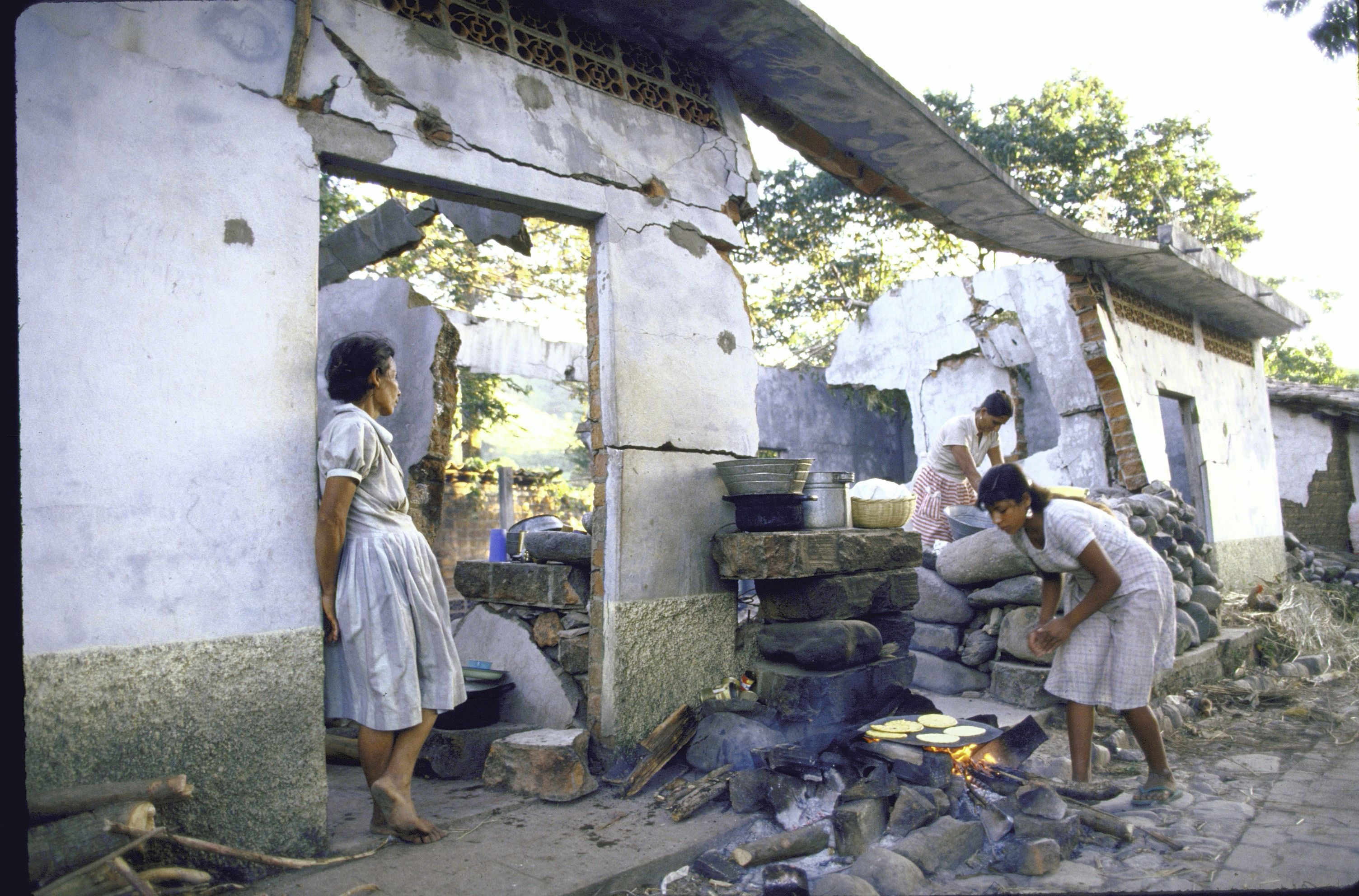 Women standing outside shell of their house; they have just returned to their village after 7 years in Honduran refugee camp.  (Photo by Cindy Karp/The LIFE Images Collection/Getty Images)