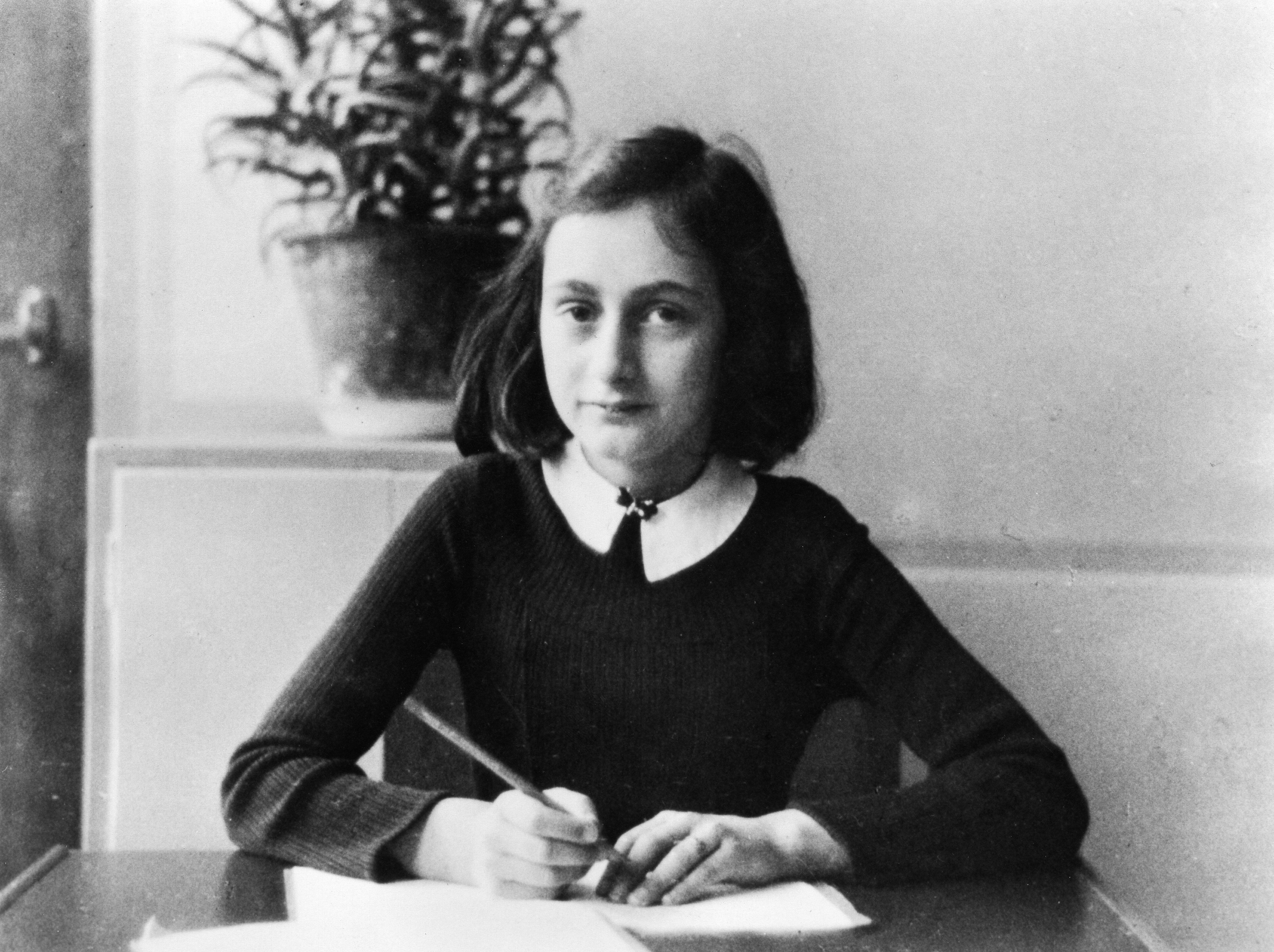 (Eingeschränkte Rechte für bestimmte redaktionelle Kunden in Deutschland. Limited rights for specific editorial clients in Germany.) ' Anne Frank, German Jew who emigrated with her family to the Netherlands during the Nazi era. Separated from the rest of her family, she and her sister died of typhoid fever in the concentration camp Bergen-Belsen - As a 12-year old doing her homework - 1941 (Photo by ADN-Bildarchiv/ullstein bild via Getty Images)