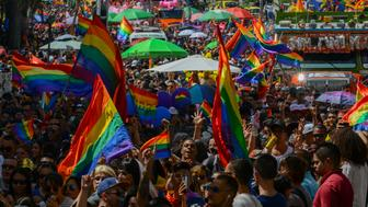 Revellers take part in the Gay Pride Parade in Medellin, Colombia on July 1, 2018. (Photo by JOAQUIN SARMIENTO / AFP)        (Photo credit should read JOAQUIN SARMIENTO/AFP/Getty Images)
