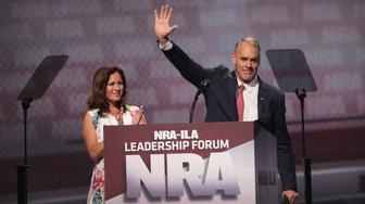 ATLANTA, GA - APRIL 28:  Secretary of the Interior Ryan Zinke alongside his wife Lolita Zinke speaks during the NRA-ILA's Leadership Forum at the 146th NRA Annual Meetings & Exhibits on April 28, 2017 in Atlanta, Georgia. The convention is the largest annual gathering for the NRA's more than 5 million members.  (Photo by Scott Olson/Getty Images)