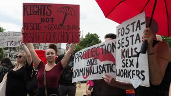 LONDON, UNITED KINGDOM - JULY 04: Sex workers and activists stage a protest outside Parliament in London as MPs debate a proposal to outlaw online prostitution platforms. The members of a cross-party group on prostitution argue that UK should follow the recent FOSTA-SESTA legislation in the US, which makes sex work advertising websites directly accountable for encouraging exploitation and trafficking. The protesters say that such legislation will make sex work more dangerous by forcing it out on the streets and removing access to databases of violent clients. July 04, 2018 in London, England. (Photo credit should read Wiktor Szymanowicz / Barcroft Media via Getty Images)
