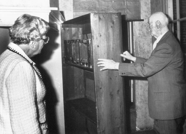 Otto Frank shows Queen Juliana of the Netherlands the entrance to his family's hiding...