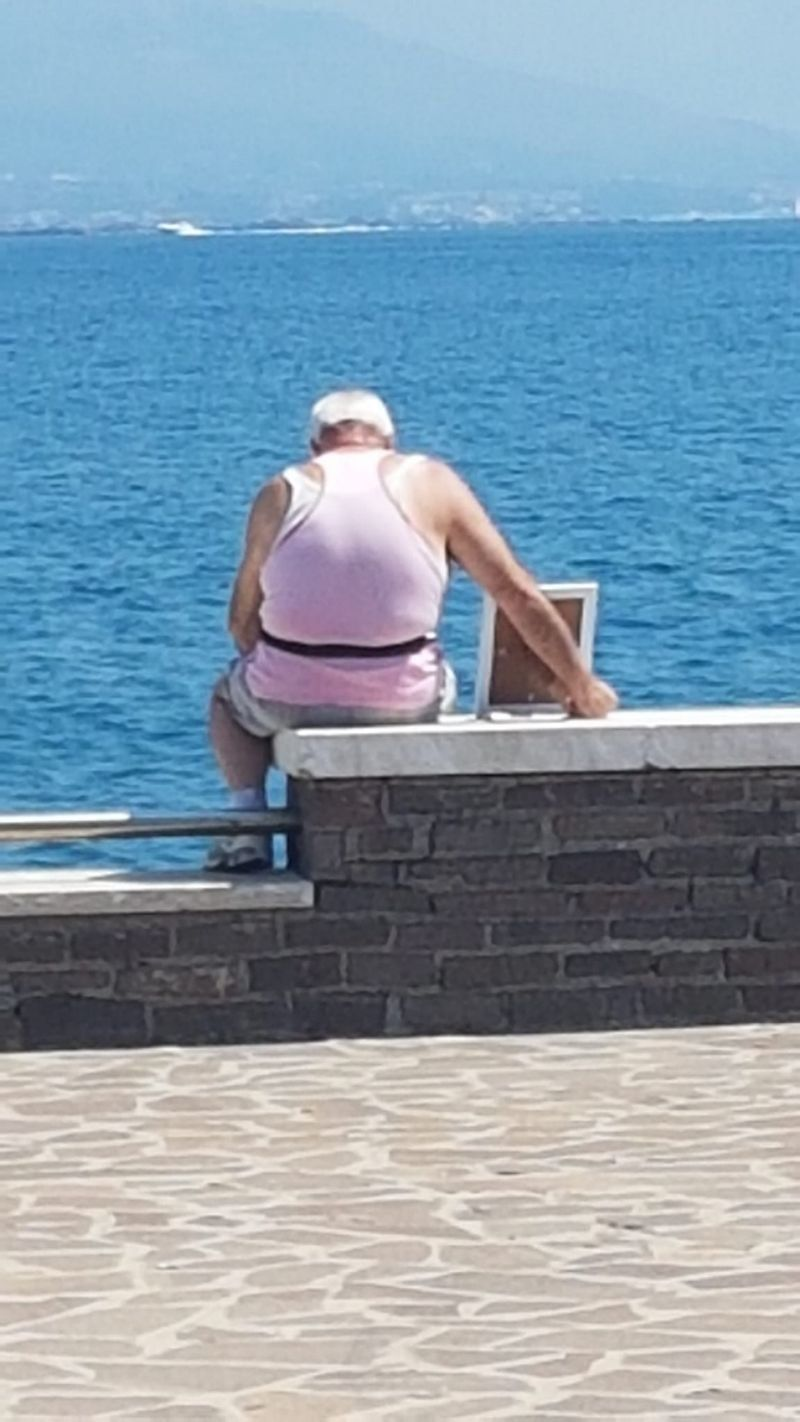 A 72-year-old widower has taken his wifes portrait to the pier where they fell in love every morning since she died seven years ago