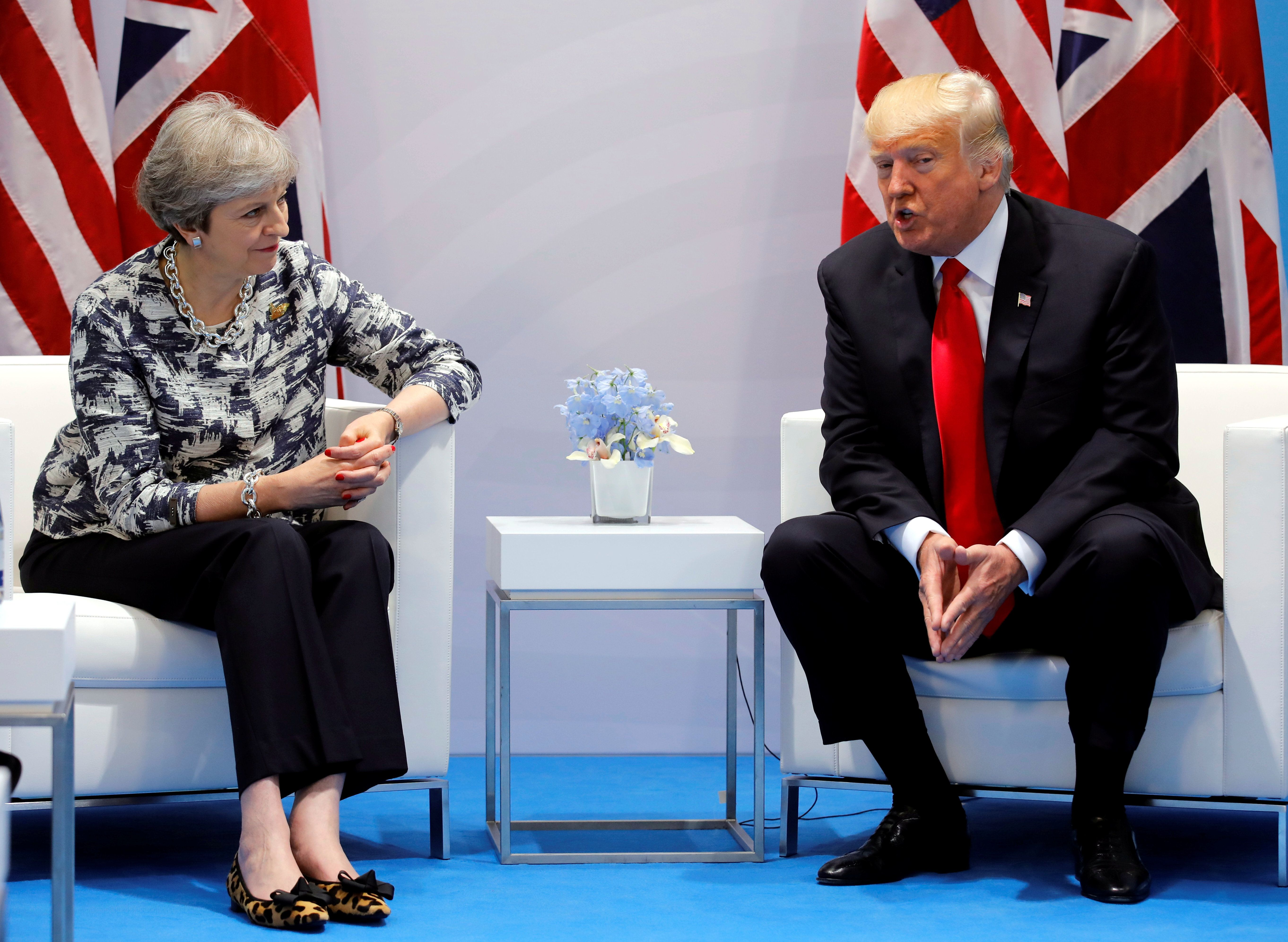 Britain's Prime Minister Theresa May talks with U.S. President Donald Trump during the G20 leaders summit in Hamburg, Germany July 8, 2017. REUTERS/Carlos Barria