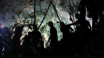 Military personnel are seen in front of the Tham Luang cave, where 12 boys and their soccer coach are trapped, in the northern province of Chiang Rai, Thailand, July 6, 2018. REUTERS/Athit Perawongmetha      TPX IMAGES OF THE DAY