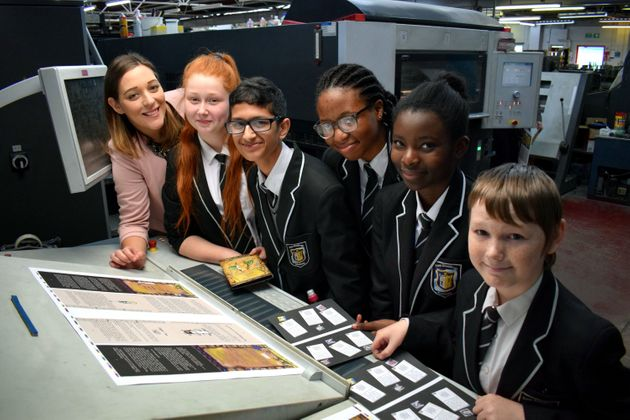 The five Year 8 pupils involved in creating the book seeing it getting