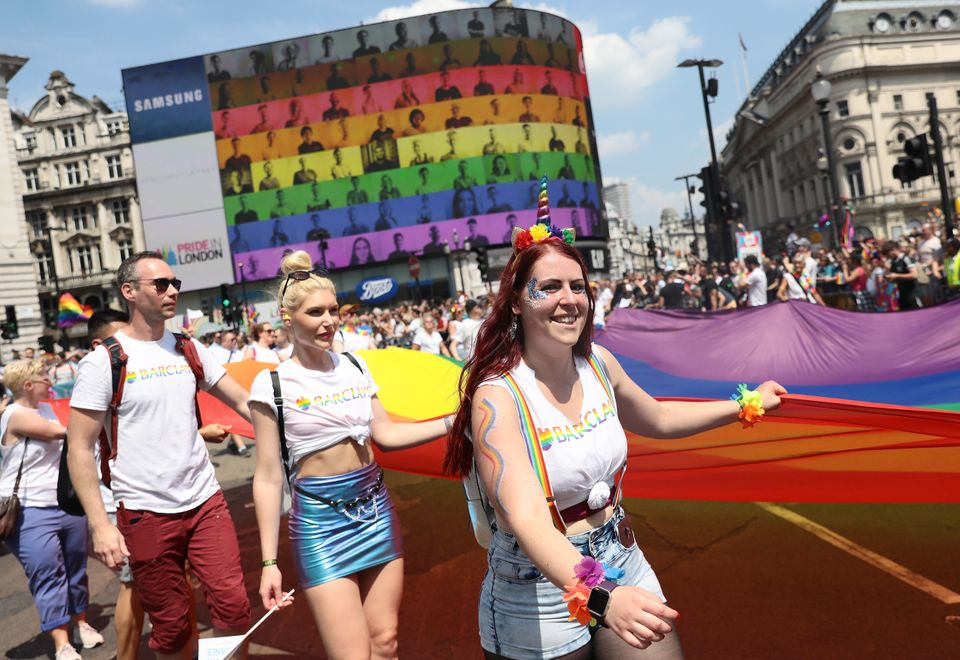 Parade goers at Piccadilly Circus during Pride In