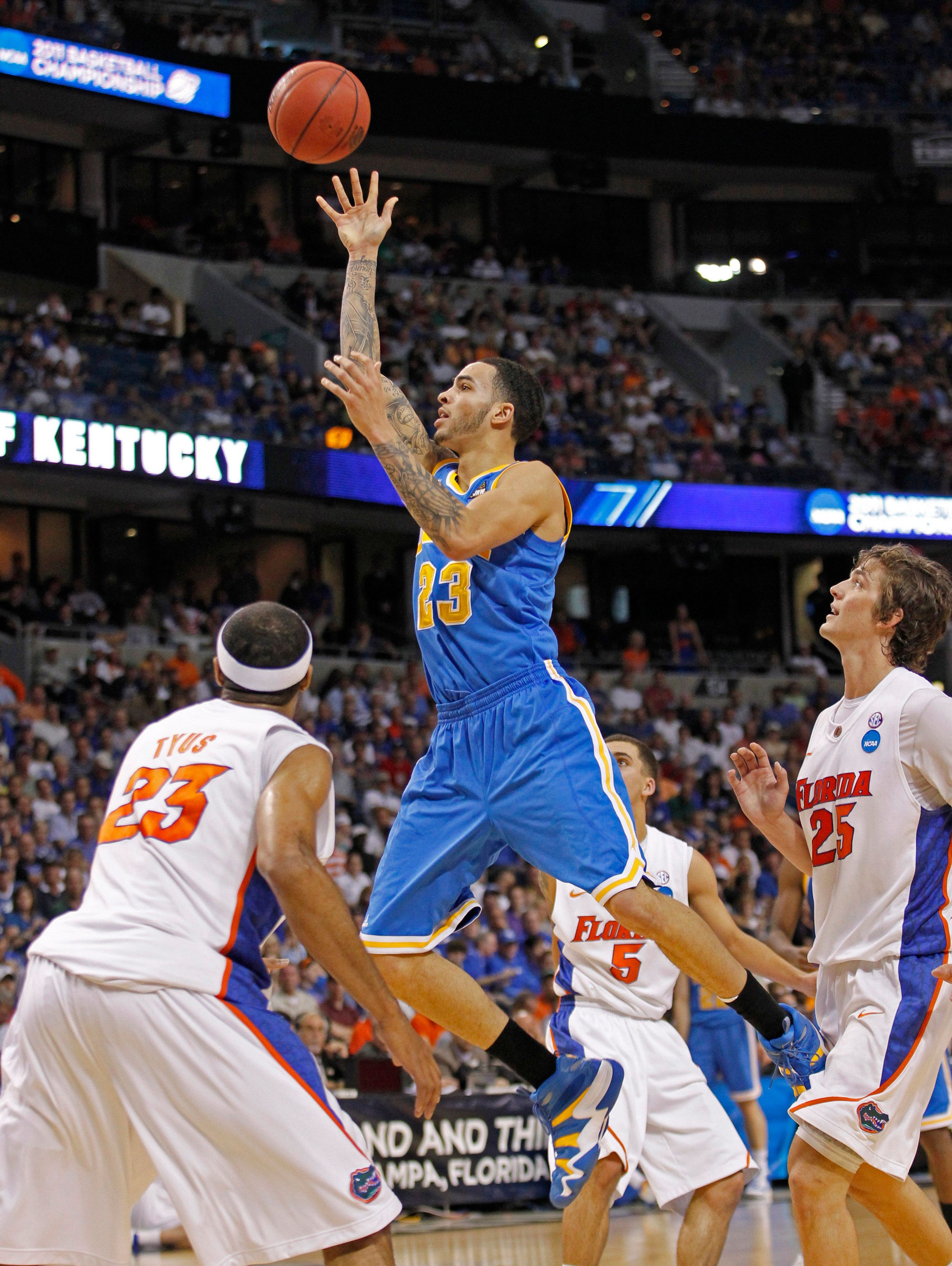 Tyler Honeycutt (top) shoots during a 2011 game when he played for the UCLA Bruins. Honeycutt was found dead early Saturday m