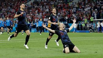 Soccer Football - World Cup - Quarter Final - Russia vs Croatia - Fisht Stadium, Sochi, Russia - July 7, 2018  Croatia's Domagoj Vida, Dejan Lovren and Josip Pivaric celebrate after winning the penalty shootout  REUTERS/Henry Romero