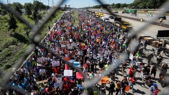 CHICAGO, IL - JULY 07: Thousands of activists march onto Chicago Dan Ryan Expressway to protest violence in the city on July 7, 2018 in Chicago, Illinois. Anti-violence protesters aimed to shut down the northbound lanes of the major interstate in an effort to press public officials to address common sense gun laws, joblessness and access to quality education. (Photo by Kamil Krzaczynski/Getty Images)