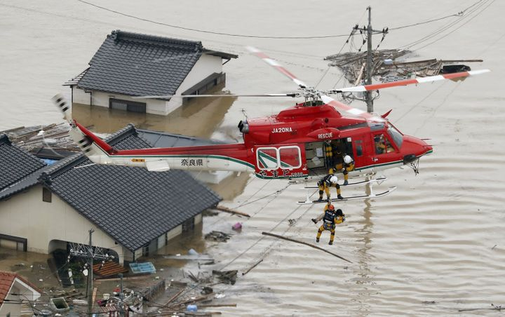 Local resident rescued by helicopter from a submerged house in Kurashiki on July 7, 2018.