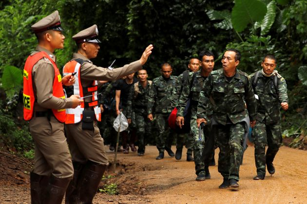 Soldiers arrive outside the Tham Luang cave complex, where 12 schoolboys and their soccer coach are trapped...