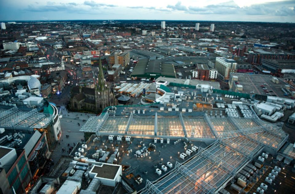 Evening view of the Bullring, St Martin's Church and Digbeth/Eastside in the background from top of The Rotunda in Birmingham