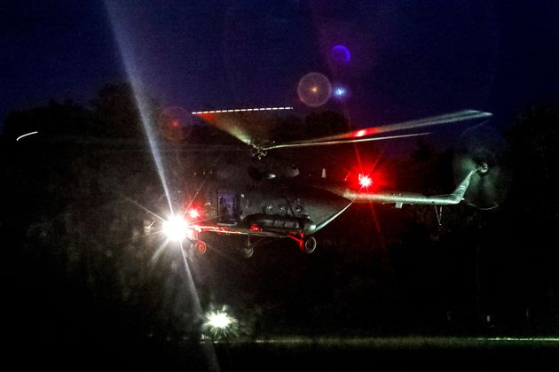 A helicopter believed to be carrying some of the rescued boys, lands at a military airport in Chiang