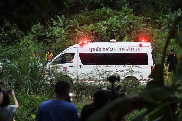 An ambulance leaves the scene at the cave