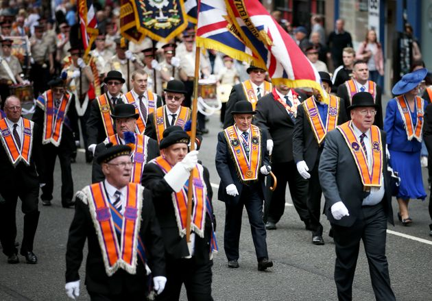 Participants taking part in Orange Walks across the city of Glasgow on