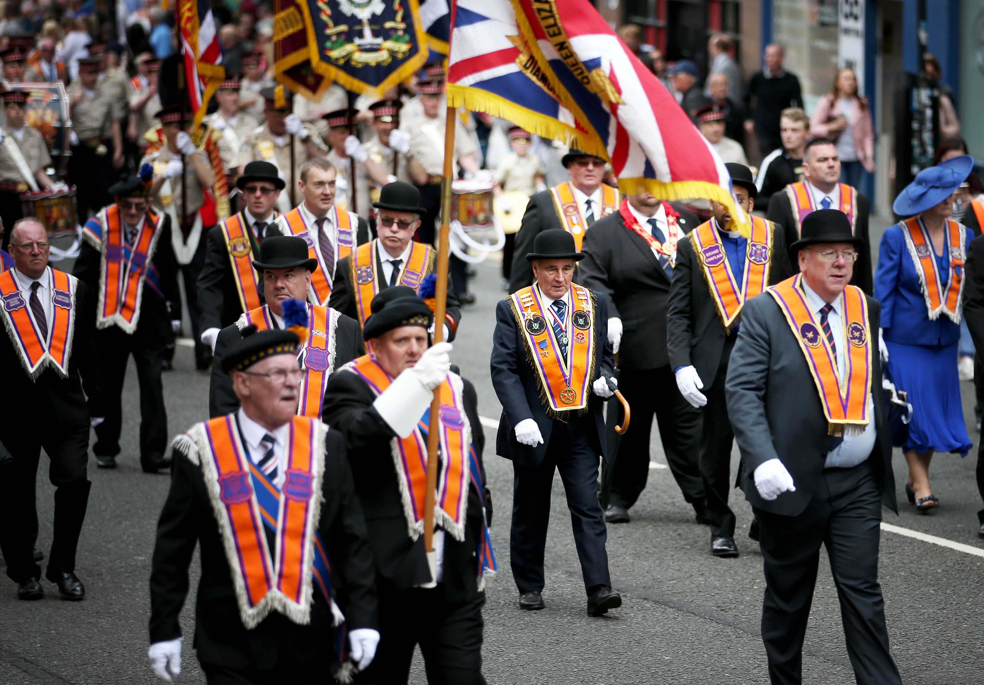 Police Investigate Claims Priest Was Spat At During Orange Walk In