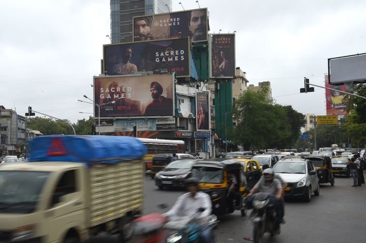 """Commuters in Mumbai travel past large billboards for """"Sacred Games,"""" India's first Netflix original series, on Wednesday."""