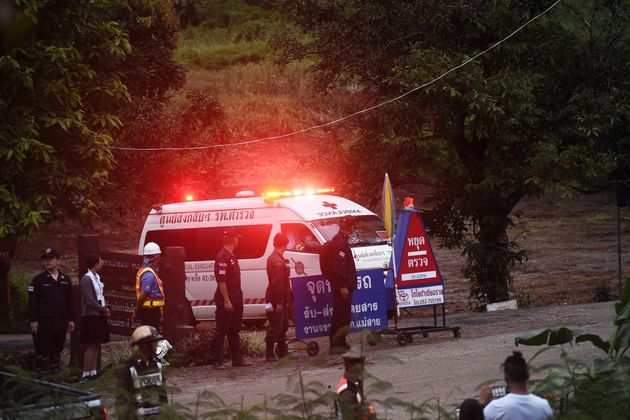 An ambulance leaves the Tham Luang cave area after divers evacuated some of the 12 boys and their coach trapped at the cave in Khun Nam Nang Non Forest Park in the Mae Sai district of Chiang Rai province on July 8.