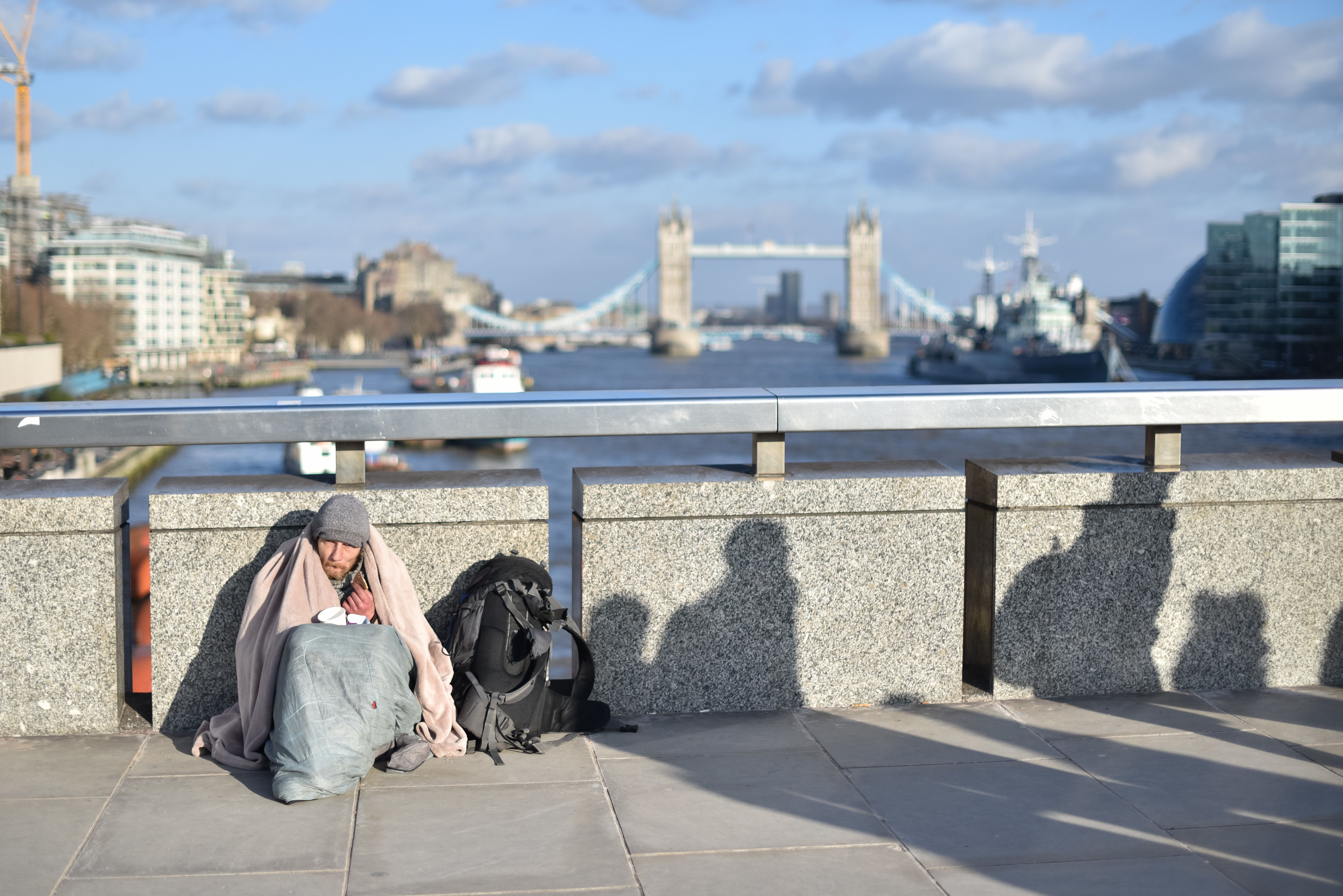 Homeless People Suffering Sunburn And Dehydration In Ongoing Hot