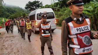 Thai policemen secure the road leading to Tham Luang cave area as rescue operations continue for those still trapped inside the cave in Khun Nam Nang Non Forest Park in the Mae Sai district of Chiang Rai province on July 9, 2018. - Four boys among the group of 13 trapped in a flooded Thai cave for more than a fortnight were rescued on July 8 after surviving a treacherous escape, raising hopes elite divers would also save the others soon. (Photo by YE AUNG THU / AFP)        (Photo credit should read YE AUNG THU/AFP/Getty Images)