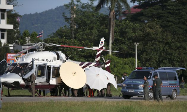 Rescued schoolboys are moved from a helicopter to an ambulance at a military airport in Chiang