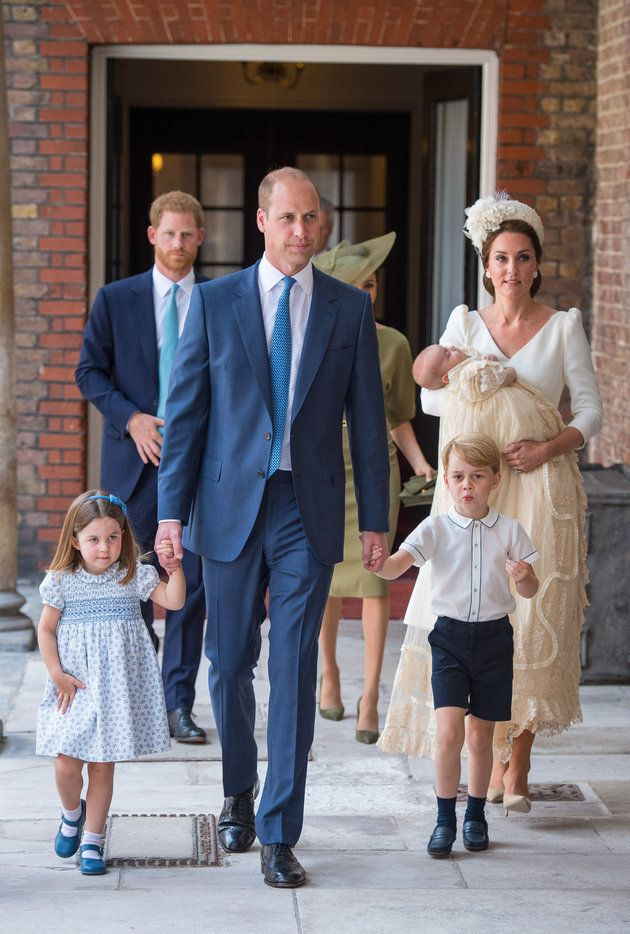 Princess Charlotte and Prince George hold the hands of their father, the Duke of Cambridge, as they arrive at the Chapel Royal, St James's Palace, London for the christening of their brother, Prince Louis, who is being carried by their mother, the Duchess of Cambridge.