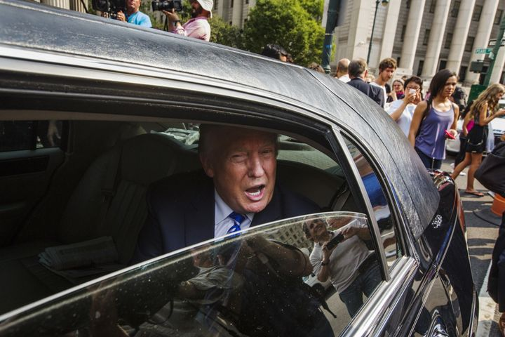Donald Trump sits in a limousine as he leaves Manhattan Supreme Court after jury duty on Aug. 17, 2015.