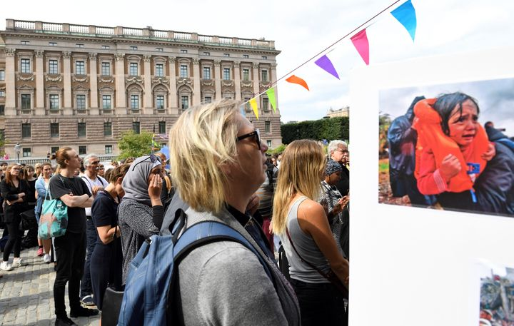 Protesters stand outside Sweden's parliament in Stockholm on June 21,2016, after lawmakers passed legislation tightenin