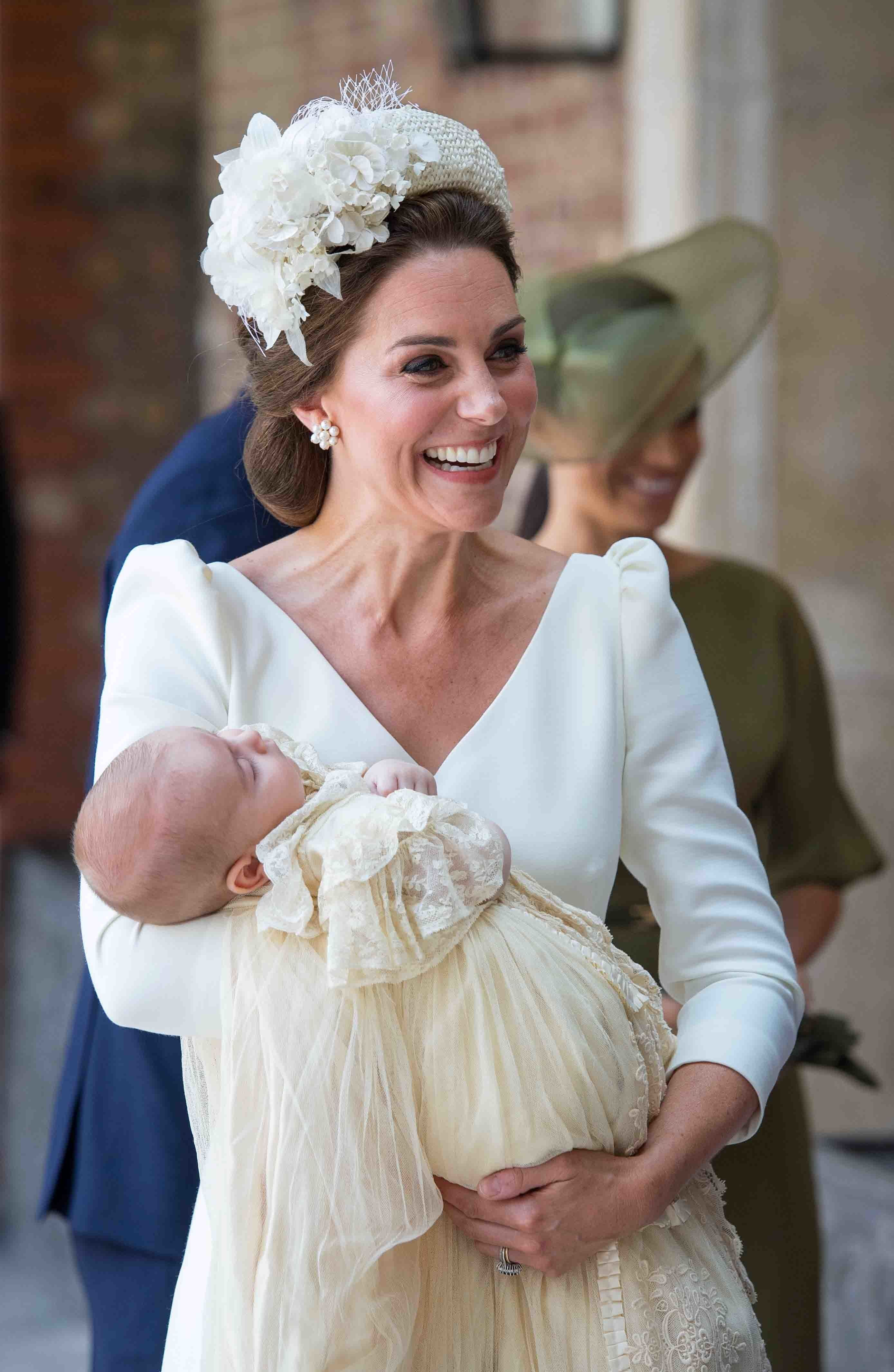 Britain's Catherine, Duchess of Cambridge holds Britain's Prince Louis of Cambridge on their arrival for his christening service at the Chapel Royal, St James's Palace, London on July 9, 2018. (Photo by Dominic Lipinski / POOL / AFP)        (Photo credit should read DOMINIC LIPINSKI/AFP/Getty Images)