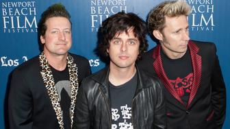 NEWPORT BEACH, CA - APRIL 25:  (L-R) Tre Cool, Billie Joe Armstrong and Mike Dirnt of Green Day arrive for the 2013 Newport Beach Film Festival Opening Night Gala premiere of 'Broadway Idiot' at Edwards Big Newport on April 25, 2013 in Newport Beach, California.  (Photo by Gabriel Olsen/FilmMagic)