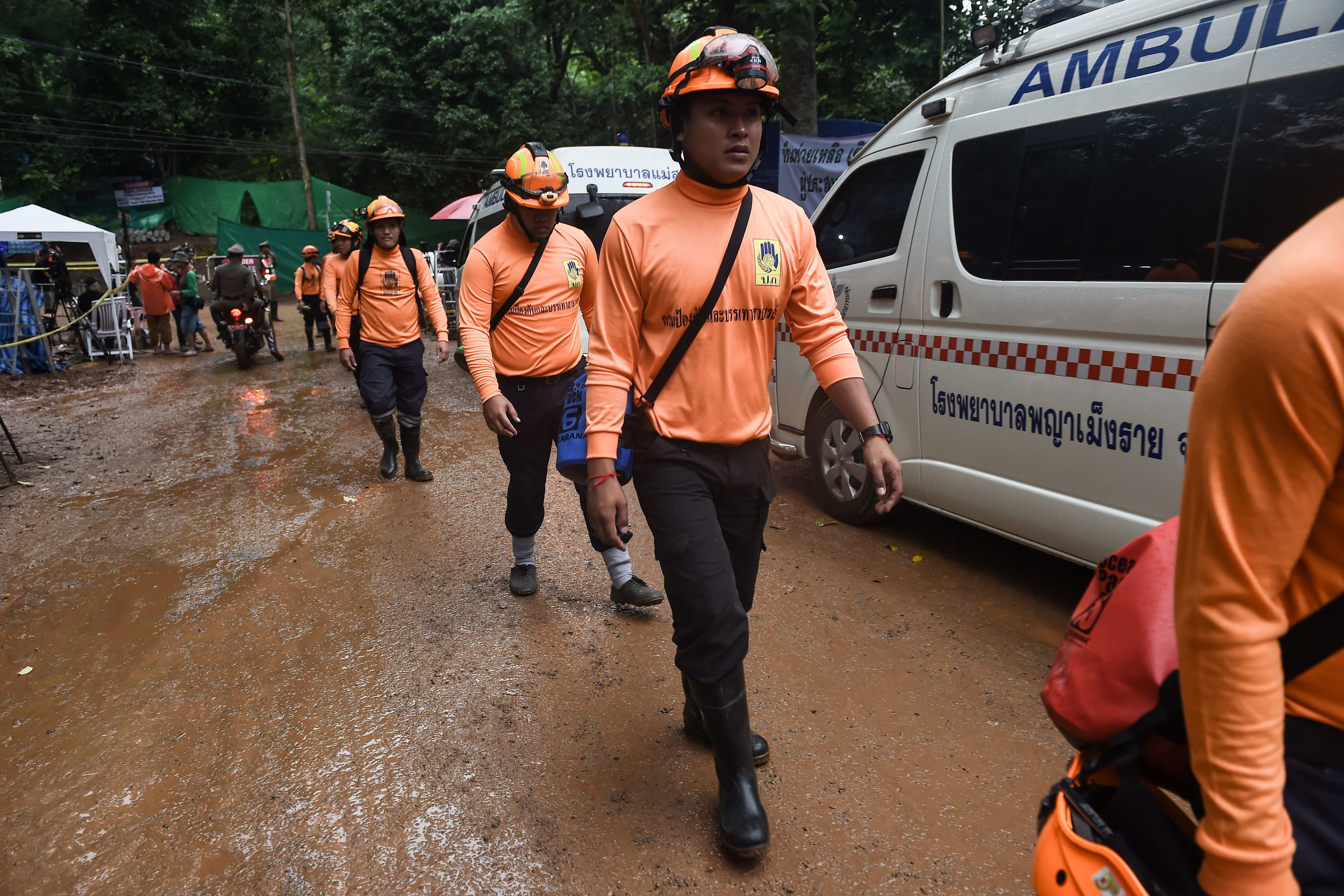 Rescue workers are seen at the Tham Luang cave area as operations continue for the 12 boys and their coach trapped at the cave in Khun Nam Nang Non Forest Park in the Mae Sai district of Chiang Rai province on July 8, 2018. - Thai authorities told media on July 8 to leave a camp site near the cave where 12 boys and their coach have been trapped for more than two weeks so that 'victims' could be helped, possibly signalling a long-awaited rescue effort to get them out. (Photo by Lillian SUWANRUMPHA / AFP)        (Photo credit should read LILLIAN SUWANRUMPHA/AFP/Getty Images)