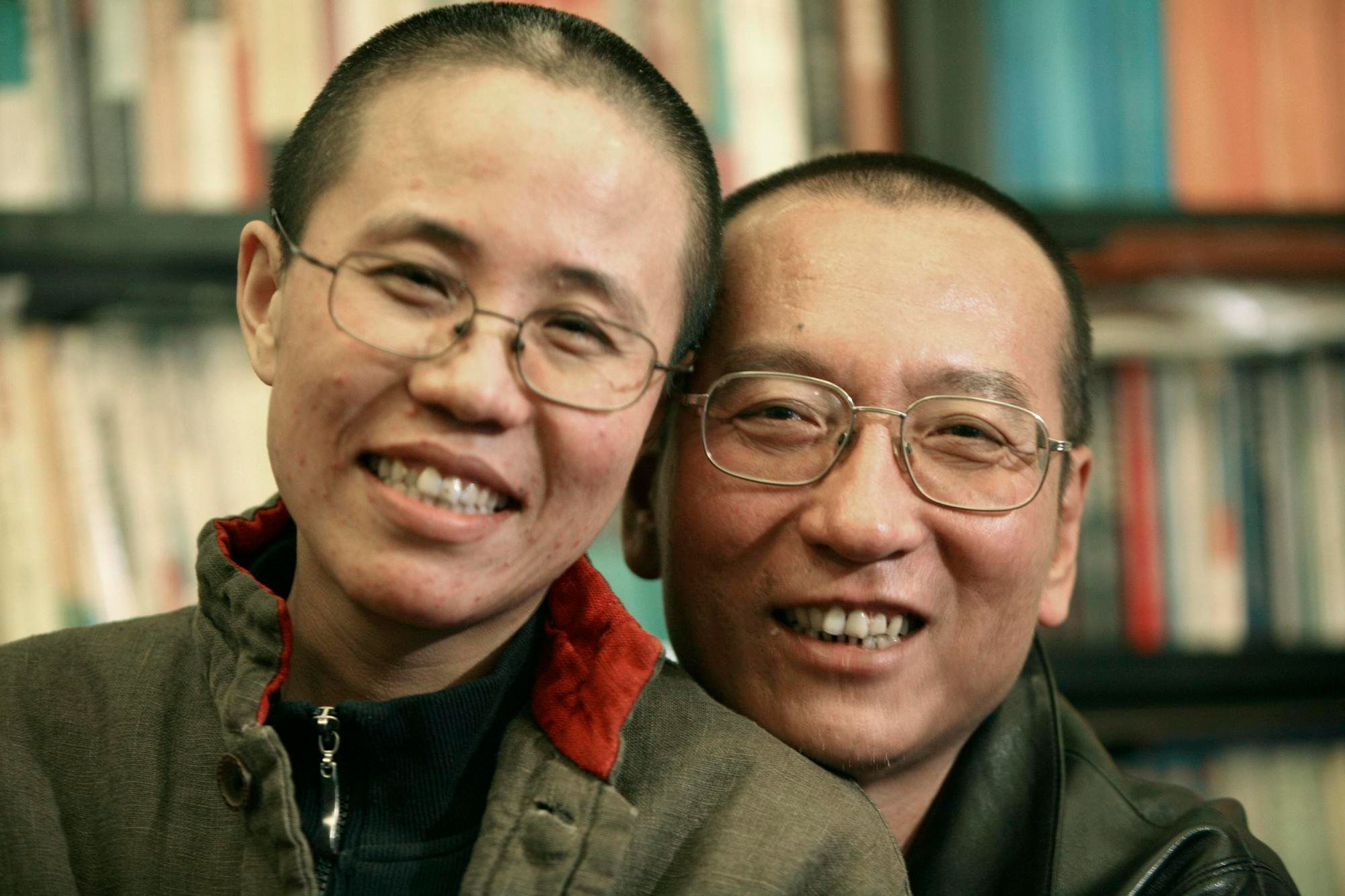Chinese dissident Liu Xiaobo right, and his wife Liu Xia pose in this undated