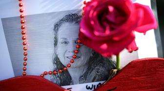 ANNAPOLIS, MD - JULY 02:  Beads, a wooden heart and flowers decorate a photograph of Wendi Winters at a makeshift memorial outside the Capitol Gazette offices July 2, 2018 in Annapolis, Maryland. Winters, 65, a local news reporter and community columnist, was killed in a shooting along with her colleagues Gerald Fischman, 61, an editorial editor; Rob Hiaasen, 59, an editor and columnist; John McNamara, 56, a sports reporter and editor; and Rebecca Smith, 34, a sales assistant. Police arrested Jarrod Ramos, 38, in the paper's newsroom and he is being held without bond on five counts of murder.  (Photo by Chip Somodevilla/Getty Images)