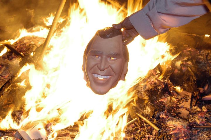 Anti-Bush protesters gather around a bonfire in London's Trafalgar Square, with thousands of protesters taking part in an ant