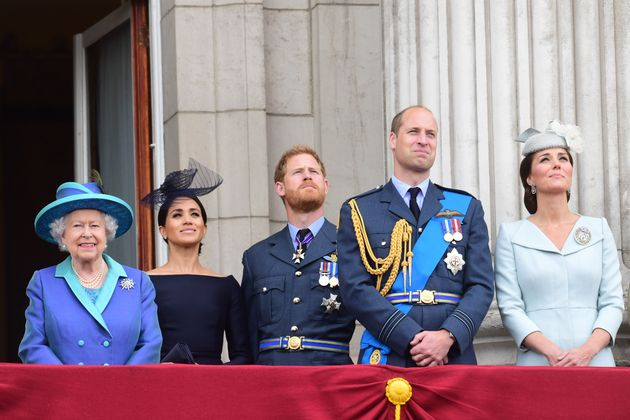 The royals observe the RAF 100th anniversary flypast from the balcony of Buckingham Palace on July 10...