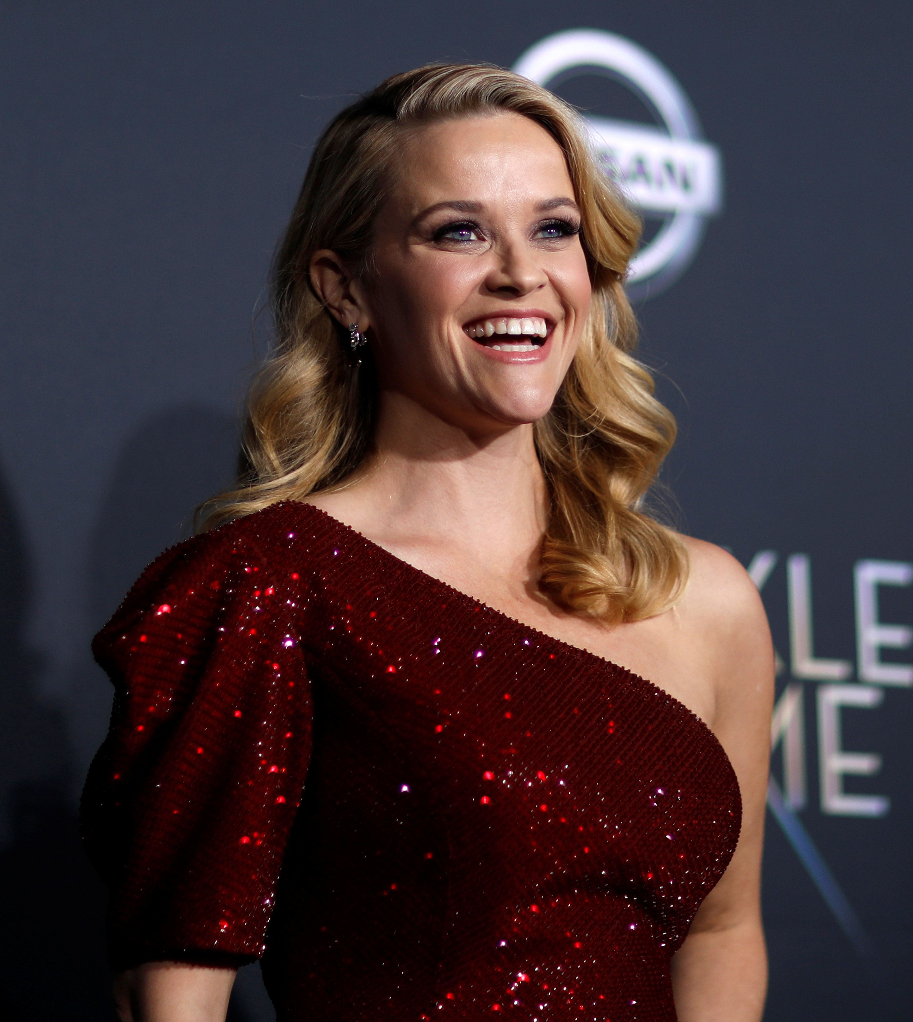 Reese Witherspoon poses at the premiere of