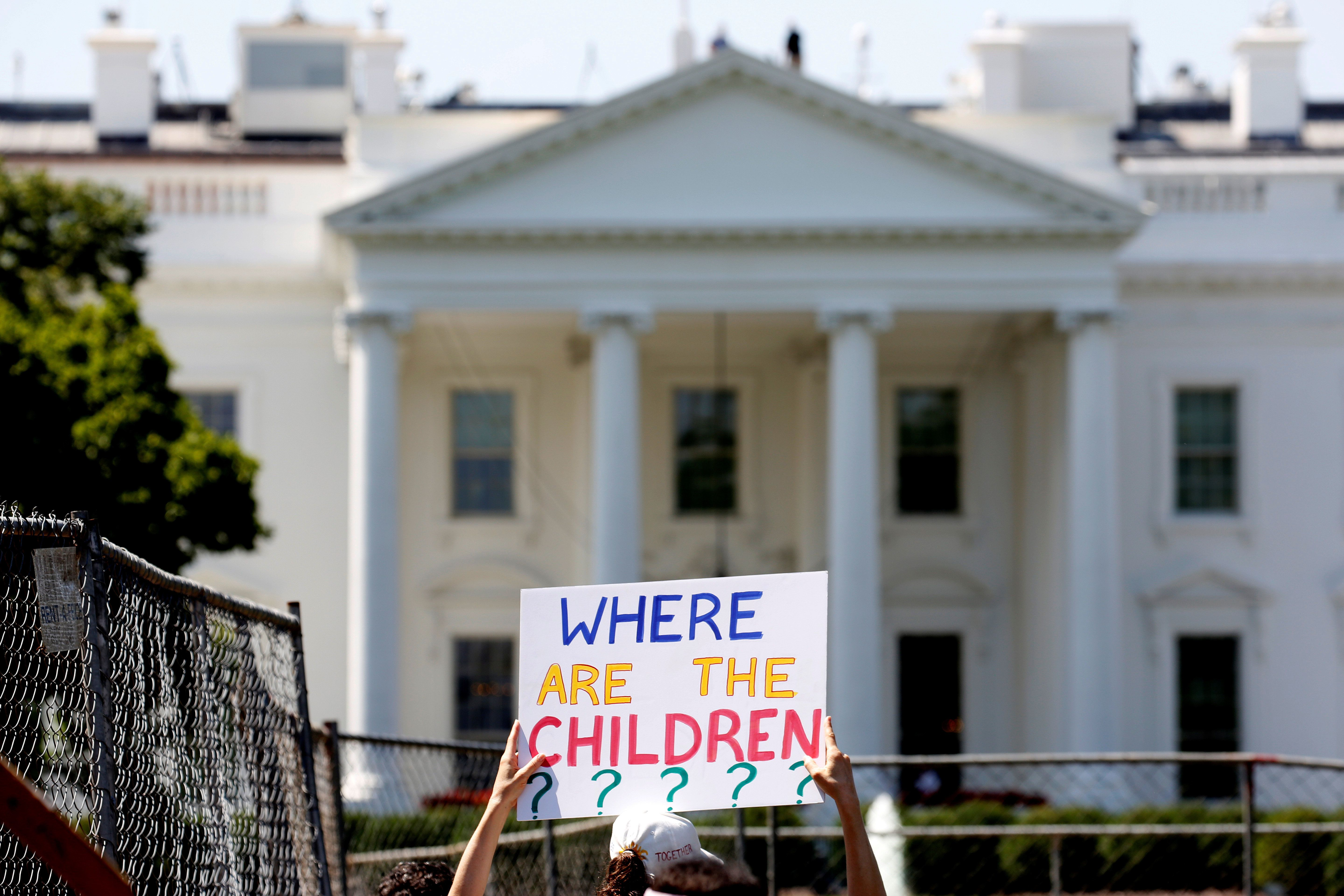 An immigration activists hold signs against family separation during a rally to protest against the Trump Administration's immigration policy outside the White House in Washington, U.S., June 30, 2018. REUTERS/Joshua Roberts