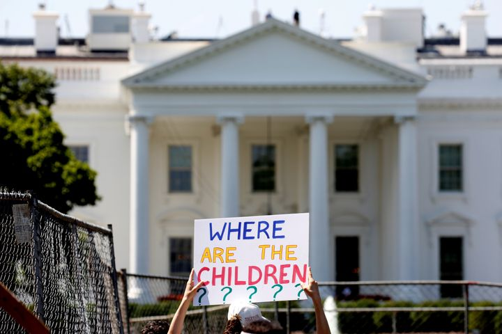 An immigration activist holds a signagainst family separation during a rally in June to protest the Trump administratio