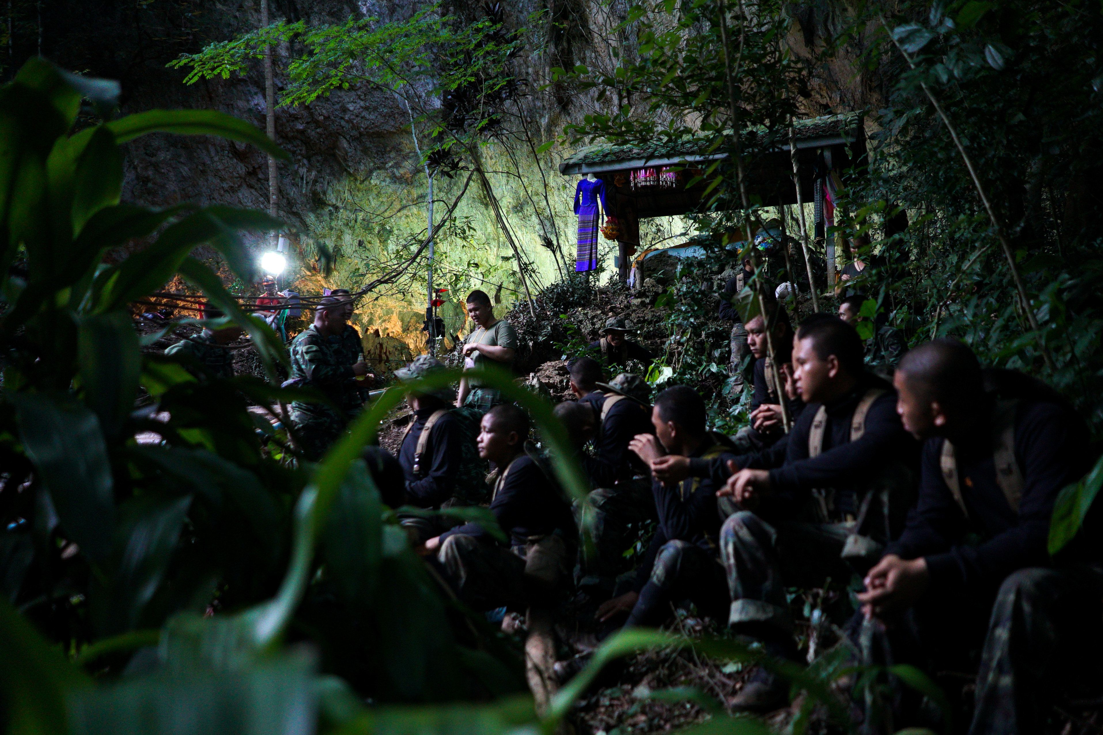 Military personnel gather as they prepare to go in to Tham Luang cave complex, as members of an under-16 soccer team and their coach have been found alive according to local media in the northern province of Chiang Rai, Thailand, July 5, 2018. REUTERS/Athit Perawongmetha