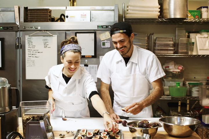 Van Leeuwen founders Laura O'Neill and Ben Van Leeuwen work with fresh figs in the kitchen of their production facility in Brooklyn, which supplies ice cream for all of the brand's New York City shops.