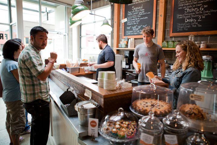 Guests line up at a Salt & Straw scoop shopin Portland, Oregon.