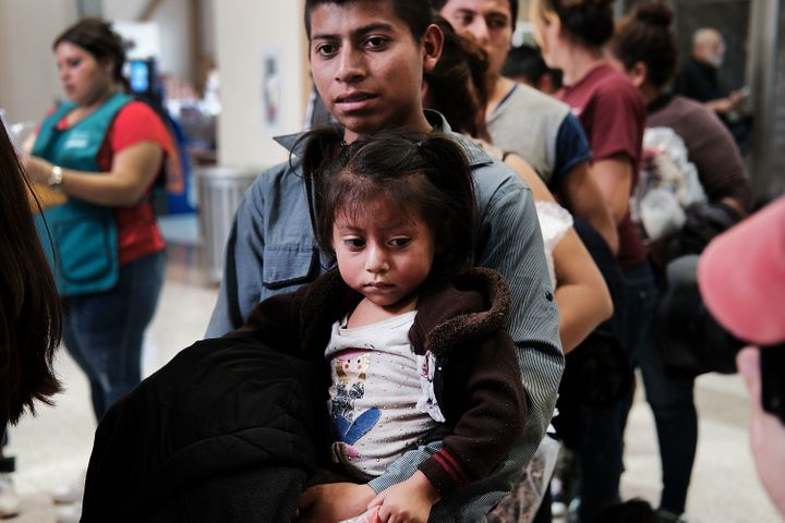 Women, men and children, many fleeing poverty and violence in Honduras, Guatemala and El Salvador, arrive at a bus station fo