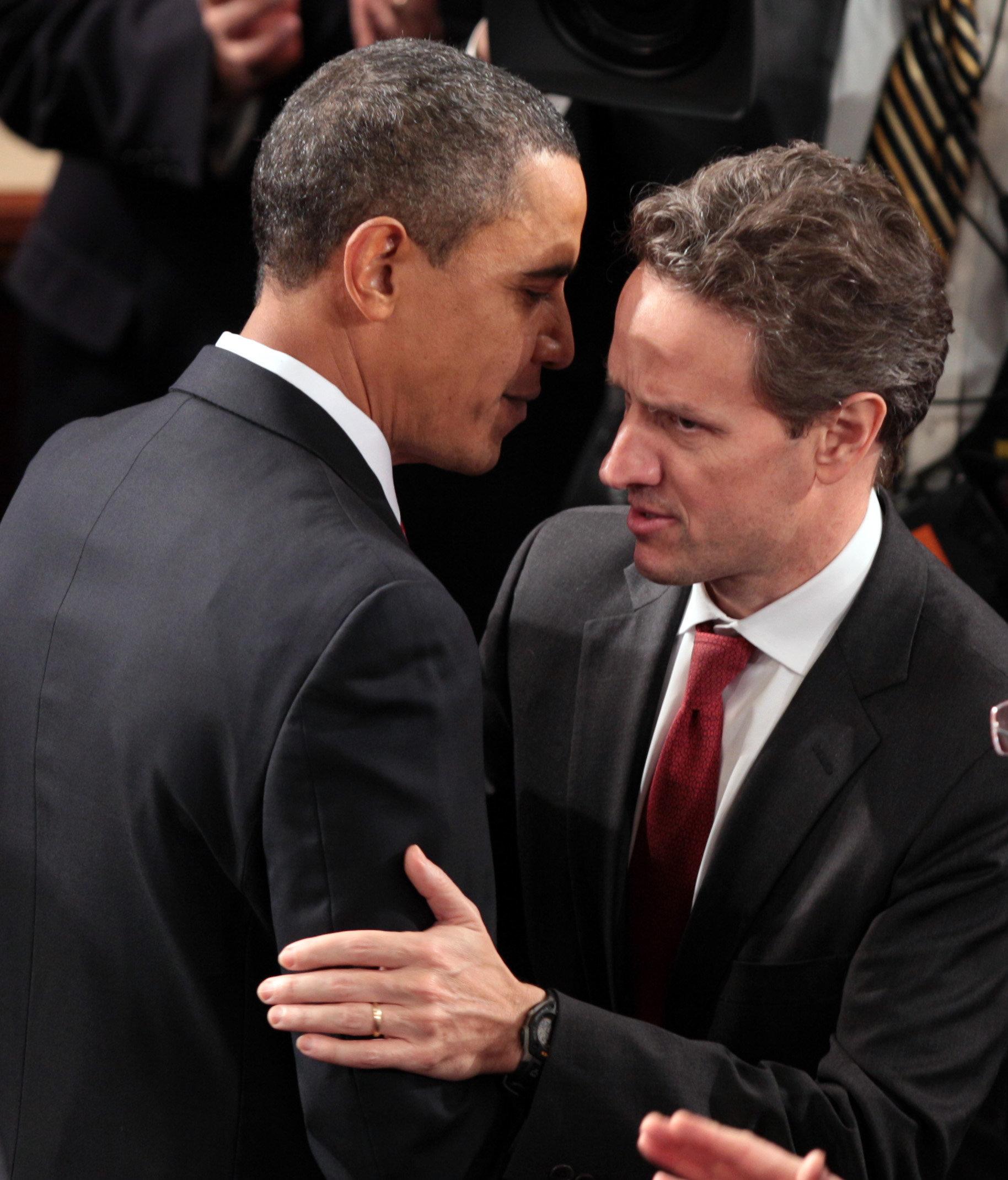 President Barack Obama greets Treasury Secretary Timothy Geithner