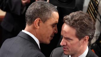 President Barack Obama greets Treasury Secretary Timothy Geithner before giving his State of the Union address to Congress on Capitol Hill, Wednesday, January 27, 2010 in Washington, D.C.  (Photo by Robert Giroux/MCT/MCT via Getty Images)