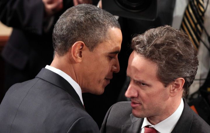 President Barack Obama greets Treasury Secretary Timothy Geithner