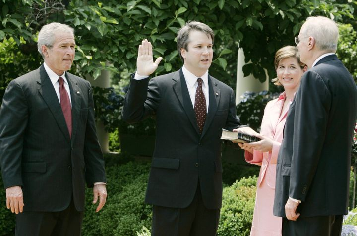 (From left) President George W. Bush, Brett Kavanaugh and his wife, Ashley Estes Kavanaugh, at his swearing-in as a judge for